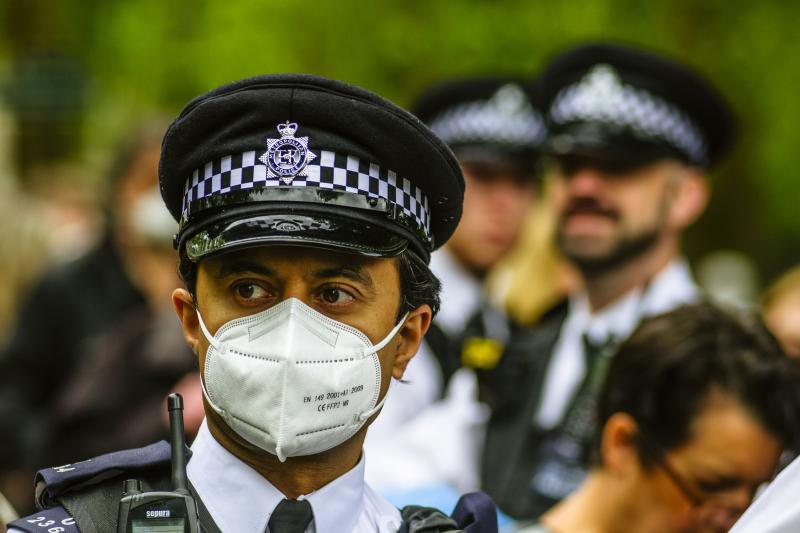 Police at an anti-lockdown protest in London, the United Kingdom, May 2020