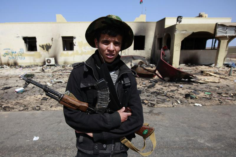 A rebel fighter in front of a bombed out Libyan Army base in Ras Lanuf, Libya,March 2011