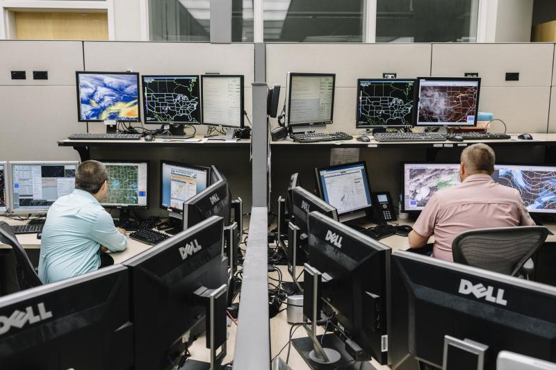 National Weather Service employees monitor storm maps and data in Norman, Oklahoma,April2019