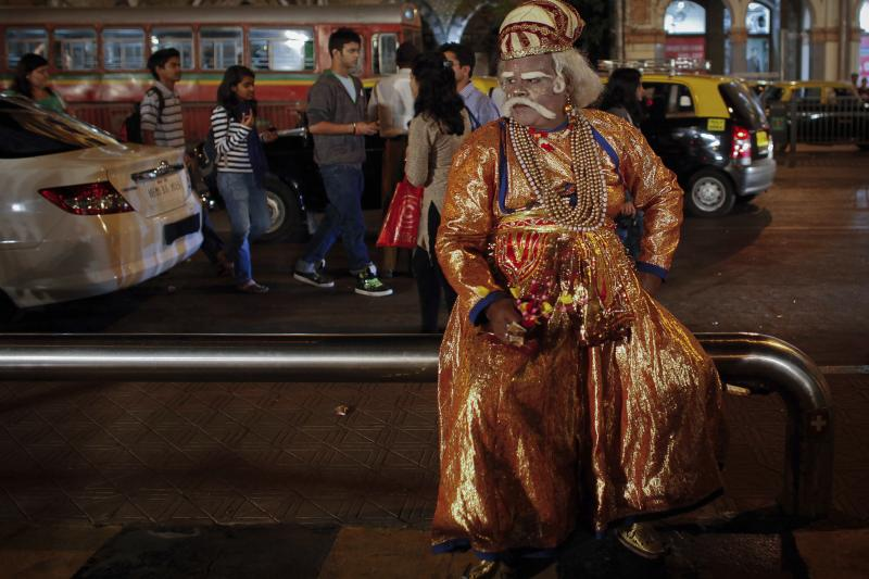 An artist dressed as the Mughal emperor Akbar sits in Mumbai, India,February2012