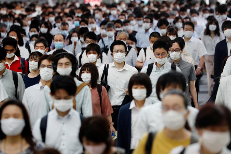 People wear masks during rush hour in Tokyo, Japan, July 2020