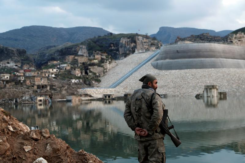 A guard stands by the Tigris River in Hasankeyf, Turkey, February2020
