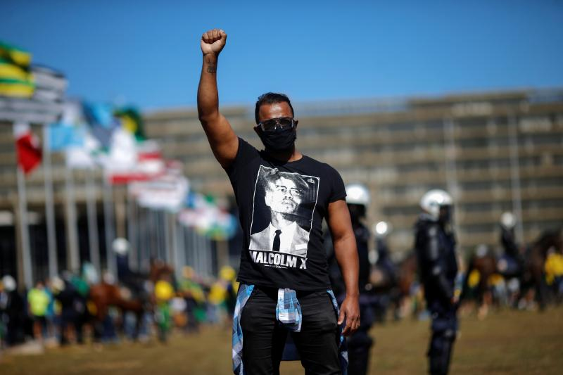 A demonstrator wearsa t-shirt with the image of Malcolm X in Brasilia, Brazil, June2020