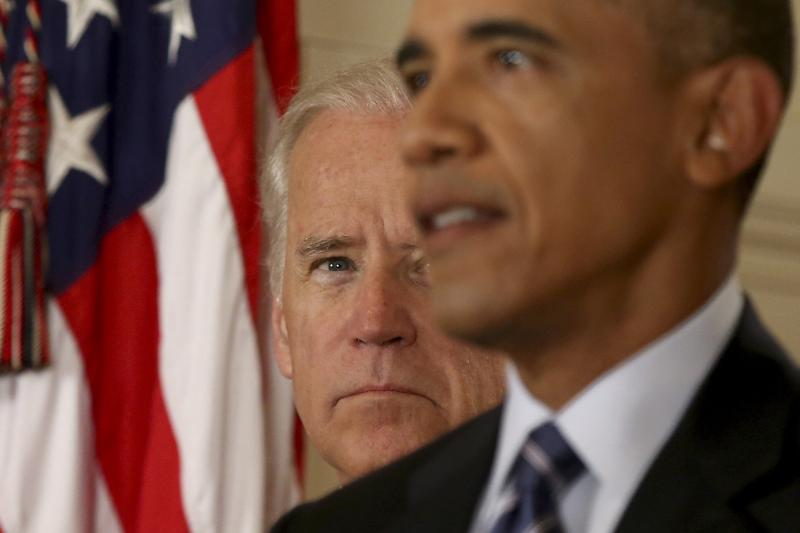 Biden watches Obama speak about the agreement of the Iran nuclear deal in Washington, July 2015