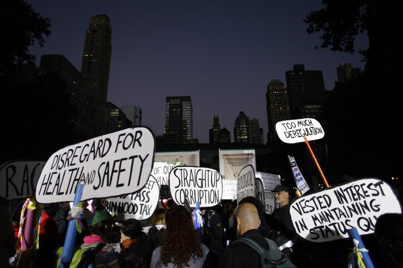 Occupy Wall Street activists protesting economic inequality gather in Bryant Park in New York City, September 2013