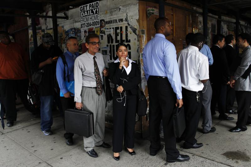 People wait in line to enter a job fair in New York August 15, 2011