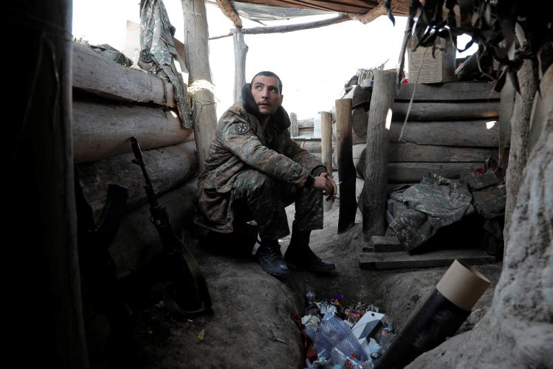 An ethnic Armenian soldier in a trench alongthe front line of fighting in Nagorno-Karabakh, October 2020