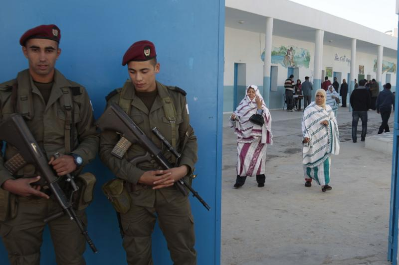 Soldiers guarding a polling place in Sousse, Tunisia, December 2014
