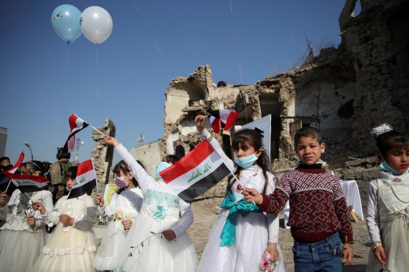 Children wait to greet Francis in Mosul, Iraq, March 2021