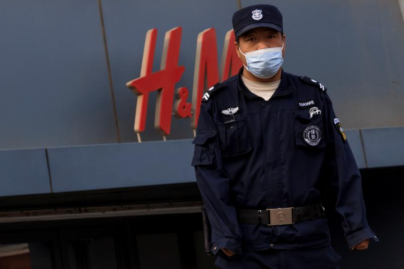 A security guard outside an H&M clothing store in Beijing, April 2021