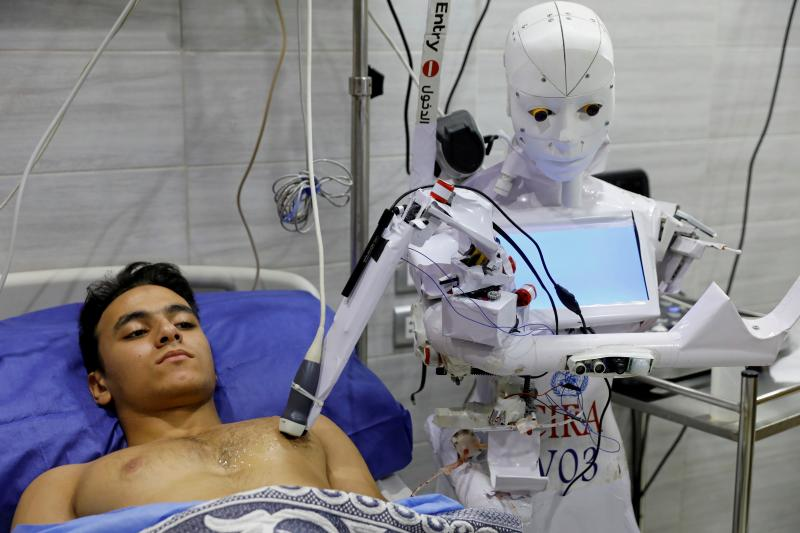 A robot running testson a COVID-19 patient in Tanta, Egypt, November 2020