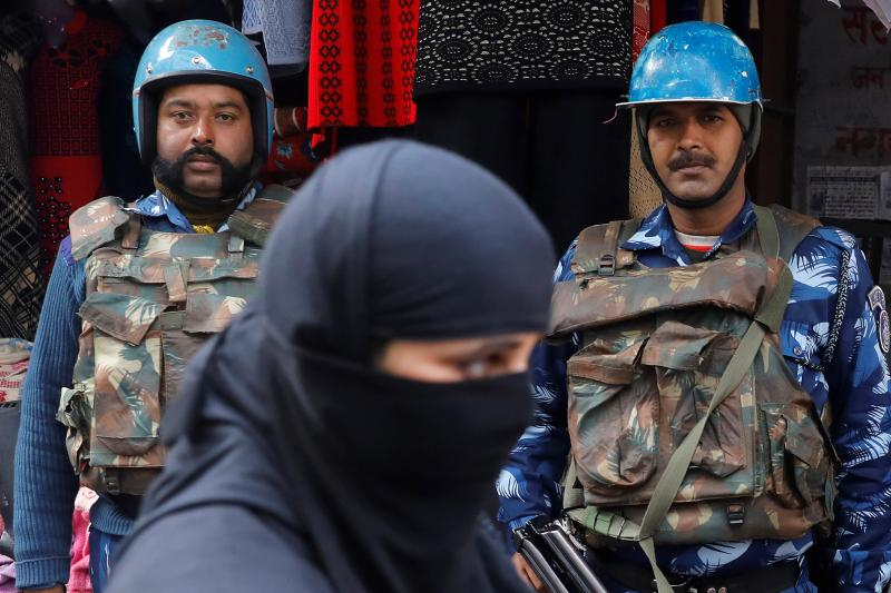 Walking past riot police in Uttar Pradesh, India, December 2019