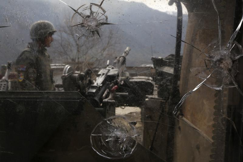 On patrol in Kunar Province, Afghanistan, February 2014