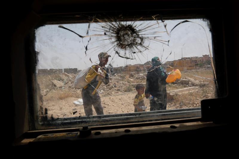 Fleeing fighting between counterterrorism forces and Islamic State militants in western Mosul, Iraq, May 2017