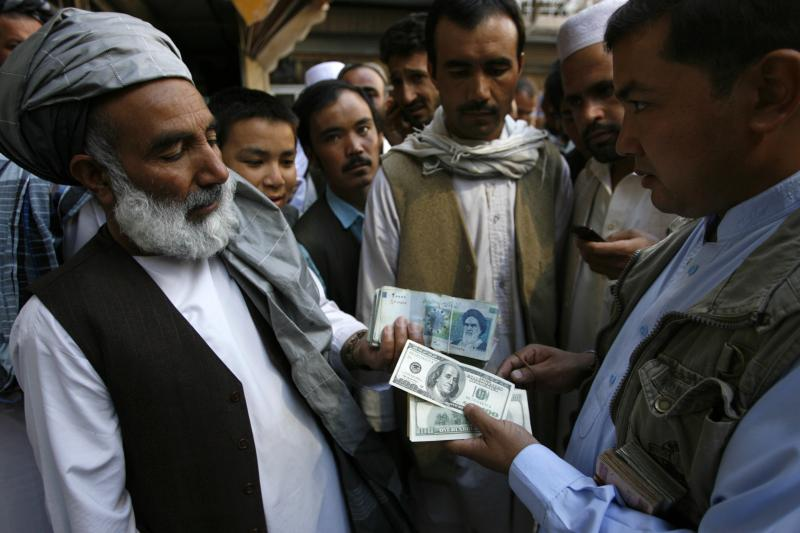 Trading U.S. dollars after an lranian currency plunge, Herat, Afghanistan,