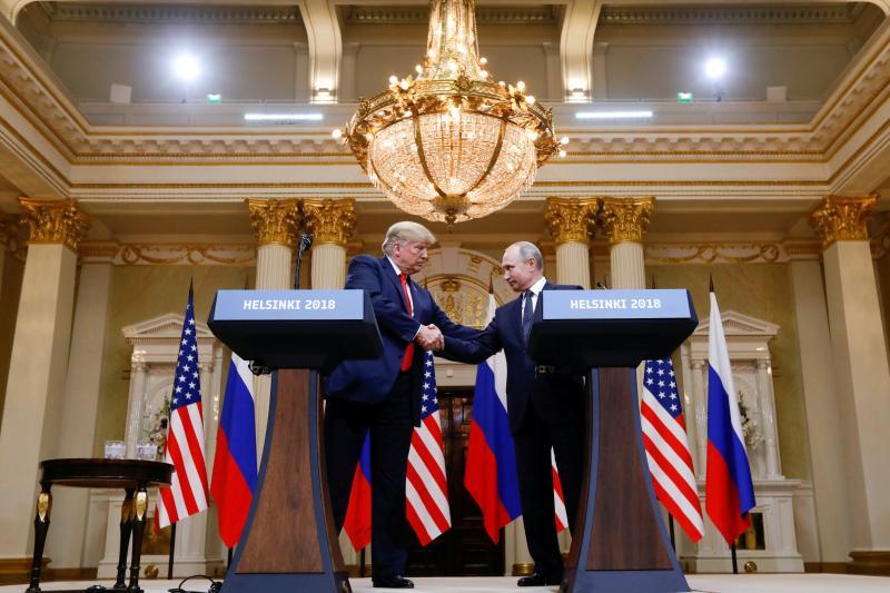Trump and Putin shake hands in Helsinki, Finland, July 2018
