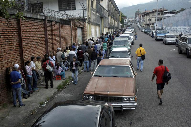 People queuing for food and gas in San Cristobal, Venezuela, November 2018