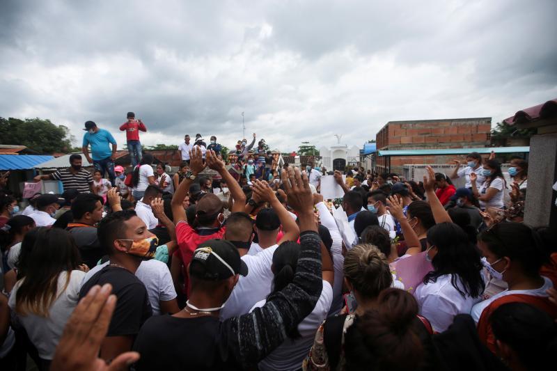 Venezuelan refugees attend a funeralin Arauquita, Colombia, March 2021