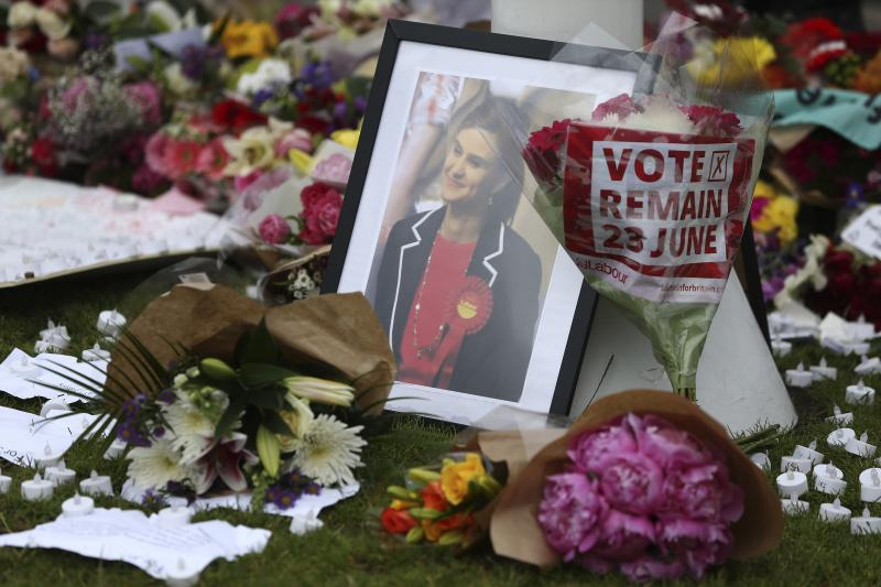 Tributes in memory of murdered Labour Party MP Jo Cox, who was shot dead in Birstall, are left at Parliament Square in London, Britain June 18, 2016.
