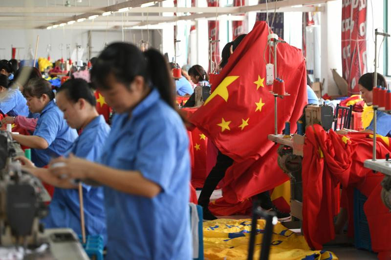 Factory workersmaking flags inJiaxing, China, September 2019