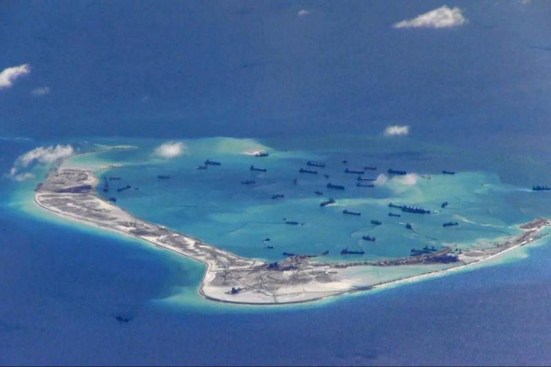 Chinese dredging vessels around Mischief Reef in the disputed Spratly Islands in the South China Sea, May2015