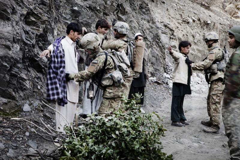 U.S. soldiers search farmers in Afghanistan, December 2009