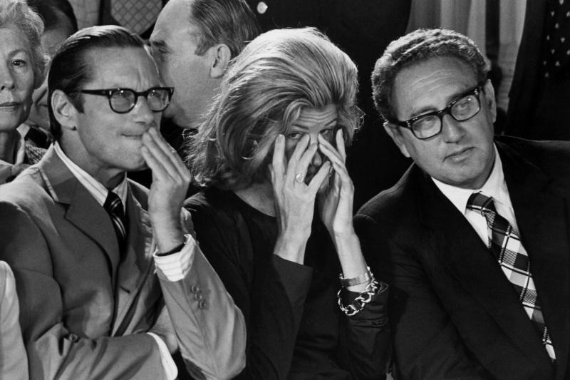 Treasury Secretary William E. Simon, Nancy Kissinger, and Kissinger listento Nixon's farewell, Washington, D.C., August1974