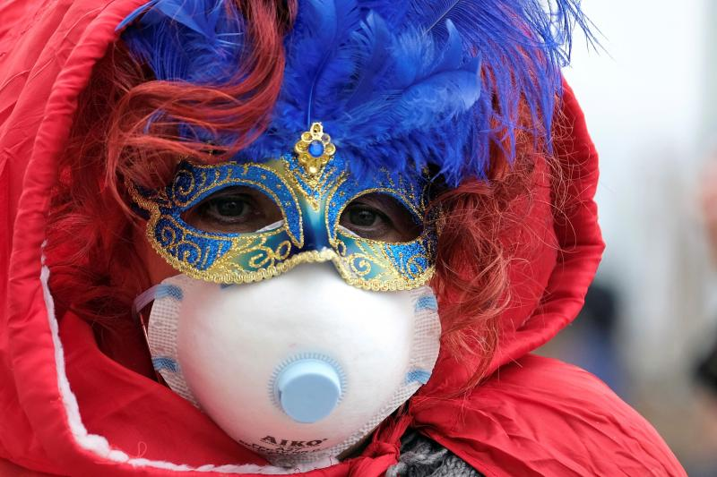 A carnival attendeewears protective face maskin Venice, Italy,February2020