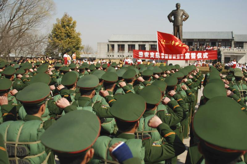 Paramilitary in front of a monument of EnlaiinJiangsu province, China, March 2008