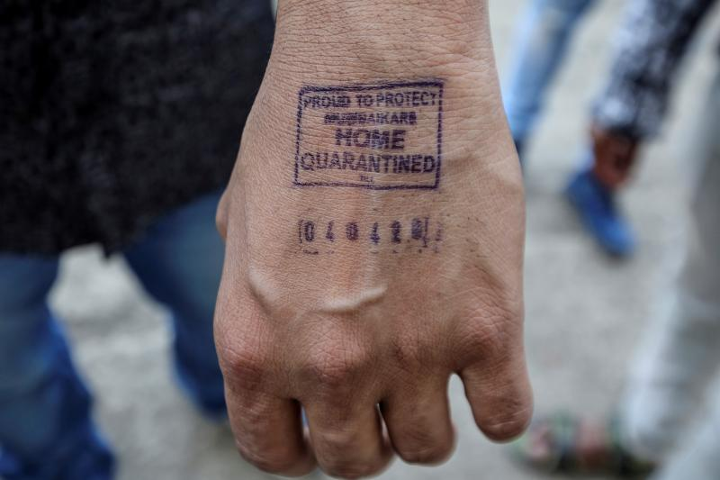 The stamped hand of a manadvised to quarantine at home after arriving from overseas,in Mumbai, India, March 2020