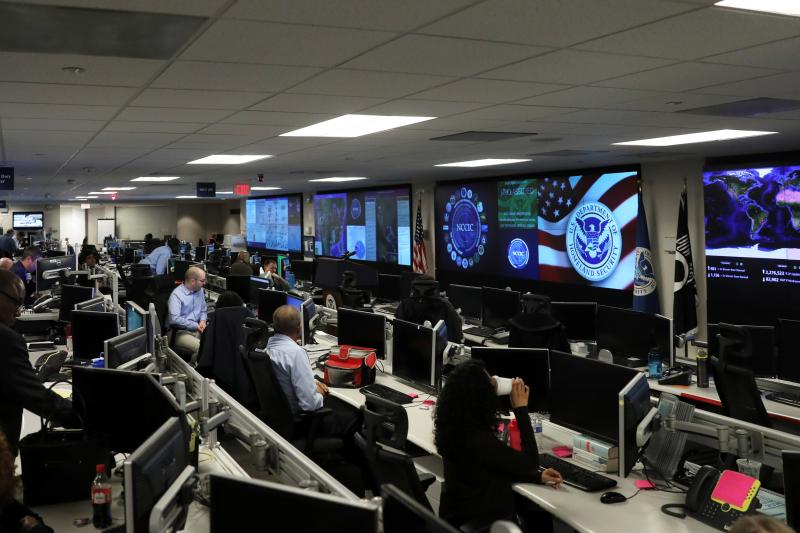 Cybersecurity workers monitor screens at the Department of Homeland Security,Arlington, Virginia, November 2018