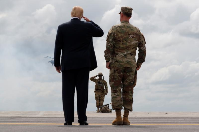 Trump salutes a U.S. Army soldierat Fort Drum, New York, August2018