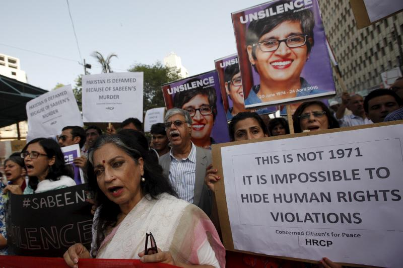 People chant slogans as they hold signs and pictures of Sabeen Mahmud, a human rights activist who was shot by gunmen, during a protest outside the Press Club in Karachi, April 30, 2015.