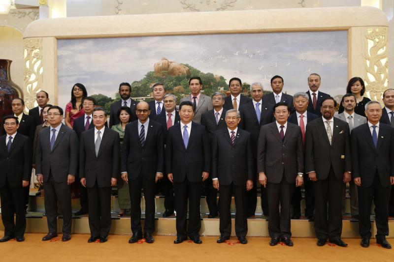 Xi Jinping poses for photos with the guests at the Asian Infrastructure Investment Bank launch ceremony in Beijing, October 24, 2014.
