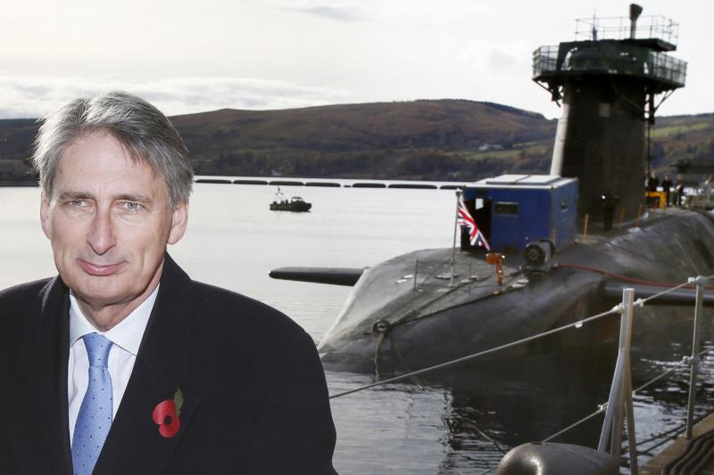 Philip Hammond, then defense secretary and now secretary of state for foreign and commonwealth affairs, poses for a photograph in front of a Trident-equipped submarine, October 29, 2012.