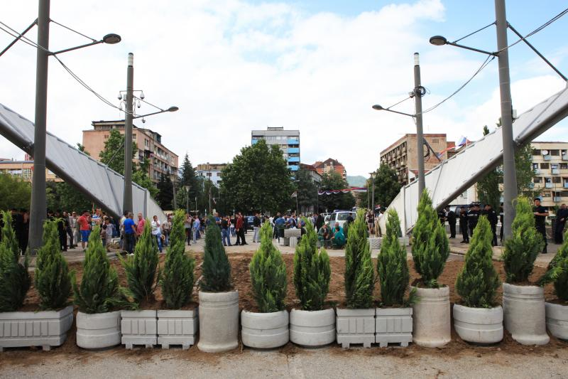 Potted plants are put in place by local Serbs to form a barricade on the main bridge in the ethnically divided Kosovo town of Mitrovica, June18, 2014.