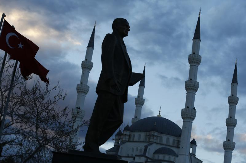 A statue of Ataturk with a mosque in the background in Kirikkale, central Turkey, March 4, 2014.