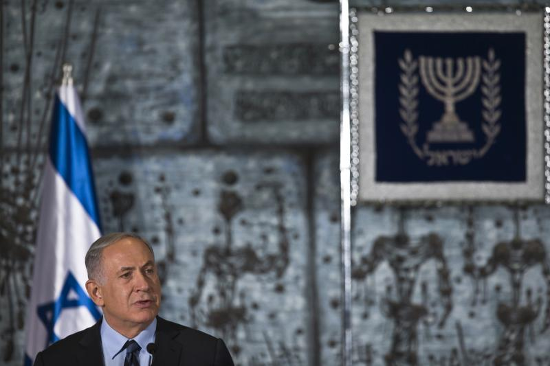 Benjamin Netanyahu speaks before a group photo with ministers of the new Israeli government in Jerusalem, May 19, 2015.