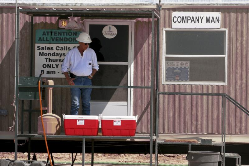 A Chesapeake Energy Corp. worker takes a break at a Chesapeake oil drilling site on the Eagle Ford shale near Crystal City, Texas, June 6, 2011.
