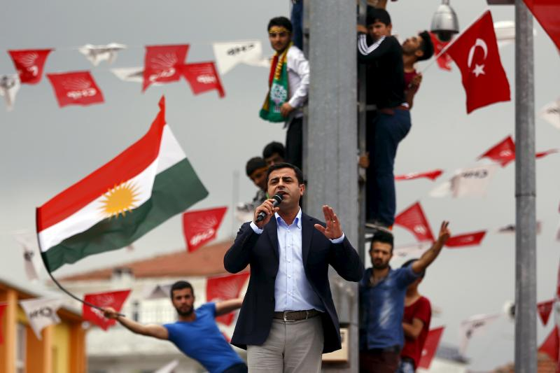 Selahattin Demirtas, co-chairman of the pro-Kurdish Peoples' Democratic Party (HDP), speaks as his supporters wave flags during an election rally in Istanbul, Turkey, June 6, 2015.