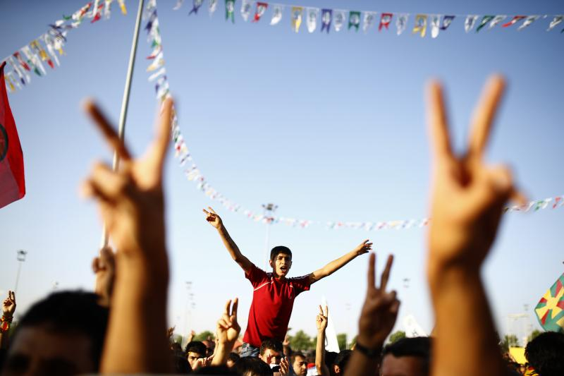 Supporters of the Pro-Kurdish Peoples' Democratic Party cheer during a gathering to celebrate their party's victory during the parliamentary election, in Diyarbakir, Turkey, June 8, 2015.
