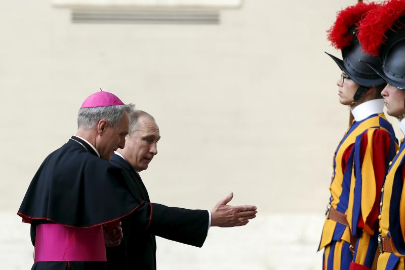 Putin is welcomed by bishop Georg Ganswein as he arrives for a private audience with Pope Francis, in Vatican City June 10, 2015.