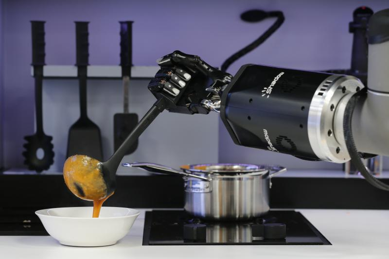 A robot in the Robotic Kitchen prototype created by Moley Robotics cooks a crab soup at the company's booth at the world's largest industrial technology fair, the Hannover Messe, in Hanover, April 13, 2015.