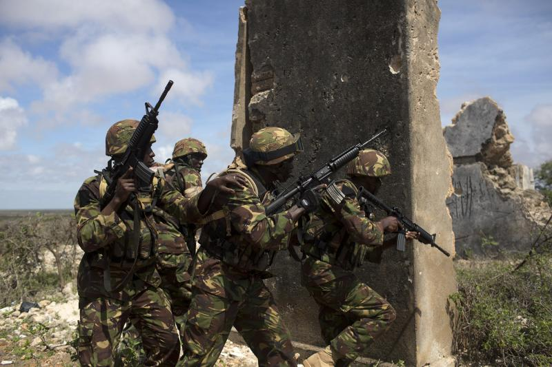 Kenya Defense Forces Rangers, who are part of the African Mission in Somalia (AMISOM), secure an area during a foot patrol on the outskirts of the controlled area of the old airport in the coastal town of Kismayu in southern Somalia, November 12, 2013.