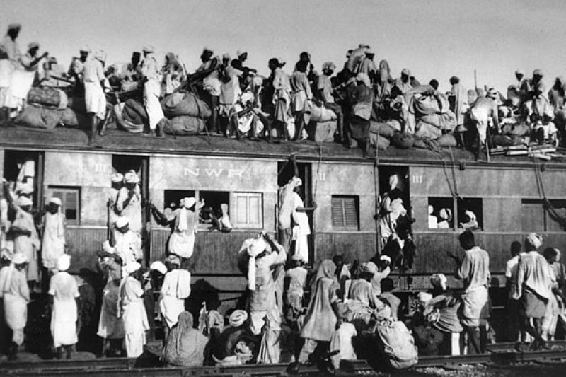 Overcrowded train transferring refugees during the partition of India, 1947.
