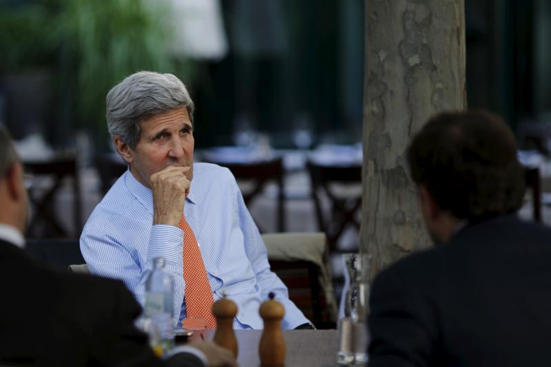 U.S. Secretary of State John Kerry, National Security Council point person on the Middle East Robert Malley (L) and Chief of Staff at the U.S. Department of State Jon Finer (R) meet on the terrace of a hotel where the Iran nuclear talks meetings are being