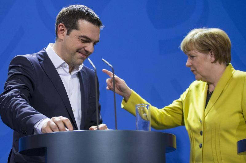 German Chancellor Angela Merkel and Greek Prime Minister Alexis Tsipras leave after addressing a news conference following talks at the Chancellery in Berlin, March 23, 2015.