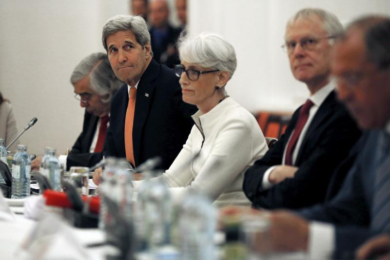 U.S. Secretary of State John Kerry meets with foreign ministers and delegations from Germany, France, China, Britain, Russia and the European Union at a hotel in Vienna, July 13, 2015.