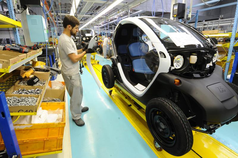 An employee works in the assembly of the new Renault Twizy Zero Emission electric car in Valladolid, October 17, 2011.