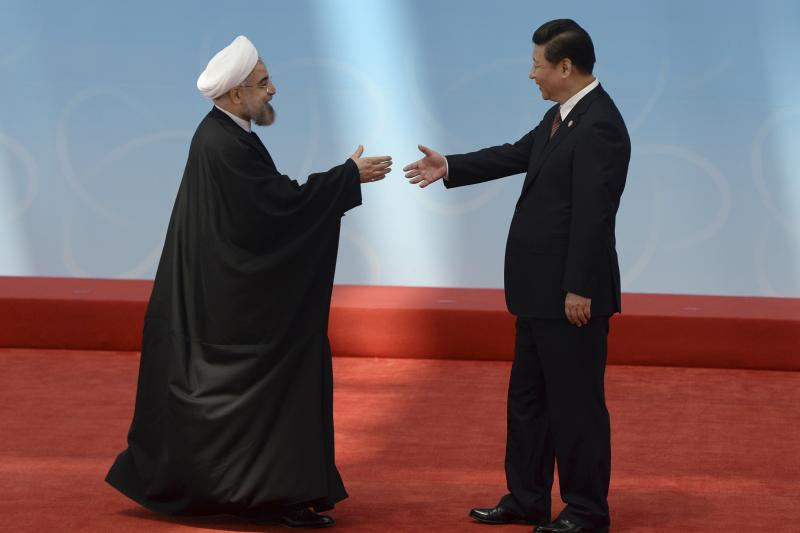Iran's President Hassan Rouhani shakes hands with his Chinese counterpart Xi Jinping before the opening ceremony of the fourth Conference on Interaction and Confidence Building Measures in Asia (CICA) summit in Shanghai, May 21, 2014.